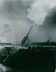 Cannon fire during war in France, Italy. 1944