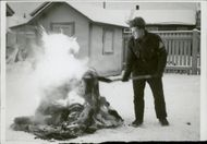 Man maintaining the fire burn.