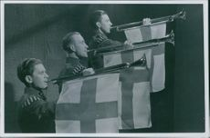 Soldiers blowing a trumpet during the Winter war, 1939.