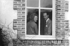 Princess Irene of the Netherlands with her husband Duke Carlos Hugo looking through the window. 1964.
