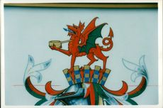 The coat of arms of Llanellia which features saucepan