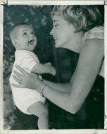 Sylvia Syms with her adopted son.