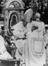 Pope Paul VI sitting.