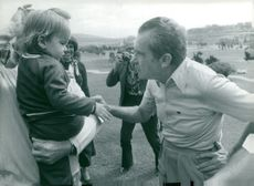 Richard Nixon greets Robert Holmes children during the charity golf round at LaCosta Country Club.