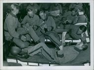 Soldiers relaxing and communicating with each other.1909