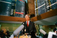 Nelson Mandela talks on the Johannesburg stock exchange during the vote.