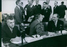 Gladwyn Jebb having discussion with another man sitting beside him.