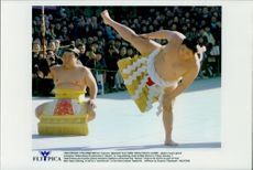 """Japanese sumo master Takanohana (th) performs a """"dezuiri"""" ritual together with the summonser Akebono sitter's briefing."""