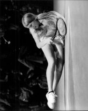 Andrea Jaeger falls during the match against Sue Barker in the Wightman Cup 1980