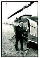 Capt Ian Evans with the helicopter in which he was hijacked.
