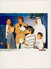 Tennis player Stefan Edberg writes autographs at tennis tournament in Dubai