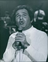 Portrait of  a French singer from Cairo, Egypt  Richard Anthony, while singing. 1968