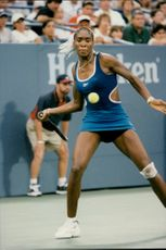 Venus Williams fires the ball to opponent Mary Pierce during the US Open.