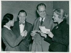 Women sell the publicist club's lottery tickets to Jarl Hjalmarsson and Tage Erlander
