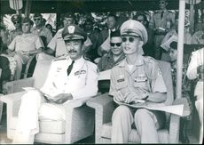Nguyễn Cao Kỳ watching amongst the crowd of military officers.