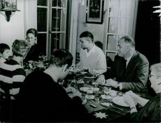 Pierre Marcilhacy having dinner with family.