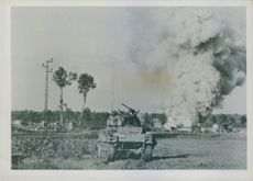 Direct hit by the American tank on a house with German snipers.