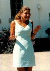 Crown Princess Victoria makes a lovely gesture to the camera during her 20th anniversary with the Solliden family.
