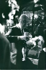 "Otto Preminger pouring water on the doll, on the set of ""Bunny Lake Is Missing"". 1965."