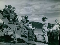 Soldiers siting on the ladder while being photographed by another soldier during Korean War 1950- 1951