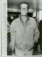"""Roger Moore arrives at Heathrow Airport after the recordings of the James Bond movie """"Octopussy"""" in India"""