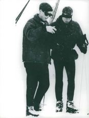 Charles Prince skiing with a man.