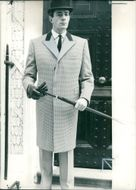 Fashions: the formal elegance of the fly front top coat.
