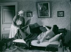 """Marianne Löfgren and Sickan Carlsson in a  scene from the 1941 Swedish movie, """"Country Storm Little Vixen""""."""
