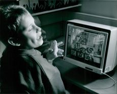A child looking television and looks happy.