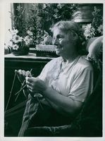 A old woman sewing during Winter War.