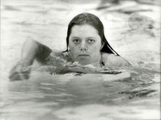 Portrait image of Gunilla Andersson taken during a swimming exercise.