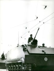 Military in tanks. April 4, 1972