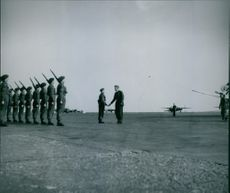 receives R.A.F. Regiment at the airport, Kastrup 1945.   Soldiers standing in attention position at the runway.