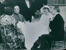 Pope Pius XII having a conversation with other people.