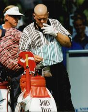 Golf player John Daly gets a blow during Scandinavian Masters 1995