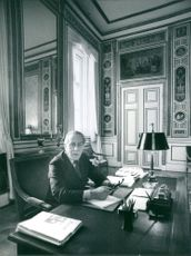 Sven Olof Morgan Andersson sitting on his desk at his office.