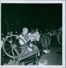 """People watch hand spinners at work.  """"Swedish __ __ to Sweden""""  1940"""
