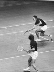 Marty Riessen in action during a double match
