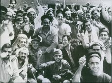 Italian prisoners smiling and giving a thumbs up after surrendering to Allied troops in Pantelleria.