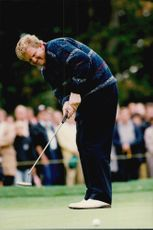 Golf player Colin Montgomerie puts under Lancome Trophy in 1995