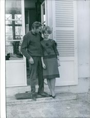 Dany Robin standing with her husband Michael Sullivan outside the house.