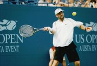 American tennis player Andre Agassi during the match against Guillaume Raoux in the US Open 1998