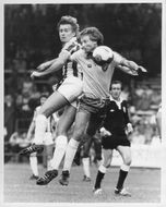 Lee Chapman and Tony Powell are fighting for the ball
