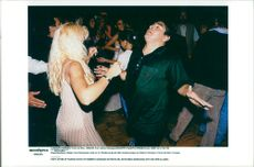 Diego Maradona releases along with his wife Claudia at the party after the fashion show by Roberto Giordano