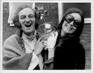 Marty Feldman and his wife Loretta show up the Silver Rose Trophy Award from Montreaux TV Festival of Light Entertainment.