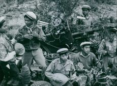 """1962  The caption to our picture, received from Hanoi, states that it shows anti-aircraft troops of the Laotian Peoples' Liberation Army""""' and claims that they have helped to bring down 102 U.S. aircraft since 1965."""