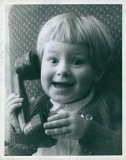 Child looks excited on call.