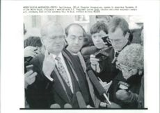 Lee Iacocca speaks to reporter.
