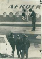 The Policeman Examining the damage.