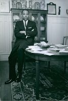 James Meredith sitting on a table.